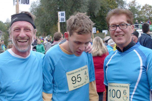 drei männliche Läufer nach dem Rennen